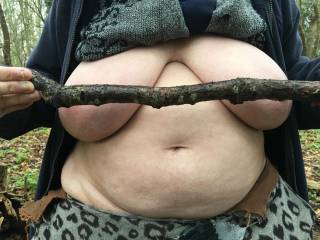 1 of 4 - both covered. We were walking in woodland and I had an idea to tease by showing her tits in various stages. My friend holds in front of her a stick.