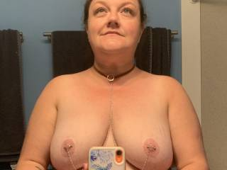 The good wench showing off her new necklace and nipple jewelry