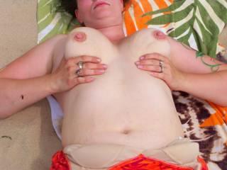 at the beach flashing her big tits
