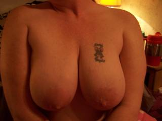 My wife showing off her big tits.  Love that they started milking again.
