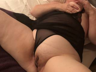 Contnuing her masturbatory fun, she uses her pussy juice lubed finger to roll around and over her nipple before resuming fingering her gorgeous cunt.