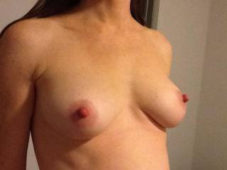 love to lick and suck on those tits and lick suck pinch twist and bite those nipples   fuck you are one hot babe
