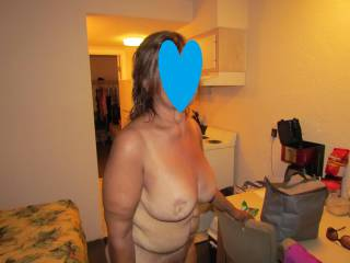 wife in hotel room after fun on the beach