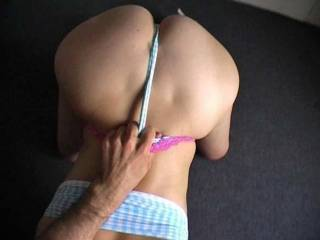 Please post more of her in this sexy outfit. I really like it. Does she like it when you pull her panties like this? Do you pull her towards you so that she swallow all of your cock?