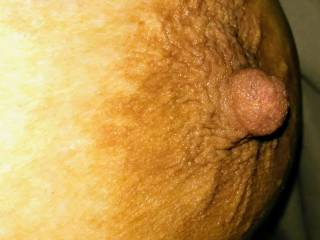 Showing a close up of my big brown nipple.