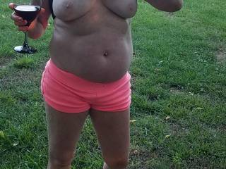 Flashing me her titties out back