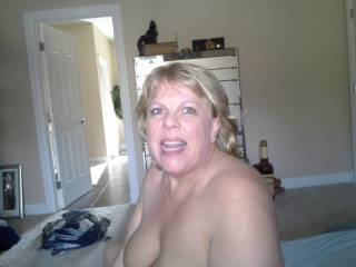 Mrs Daytonohfun covered in her cuckold hubby\'s cum.  She was sitting there with my load in her pussy and all her hubby can do is cum on her face!!!