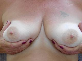 Sitting outside showing off my titties to boyfriend. Do they look okay for a 52 year old woman?