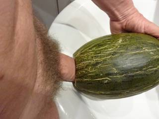 Masturbating with a juicy melon fruit imagening some hot ladies sucking on and fucking with my dick