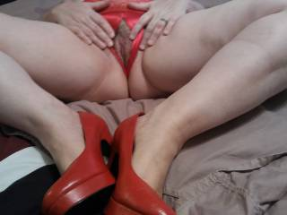"""I love to spread my legs with my red """"fuck me pumps"""", and showing off my soaking wet  pussy that needs a man\'s hard, thick, and juicy cock inside of it!"""