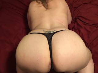 Bent over with her thong on and and wanting me to use her ass