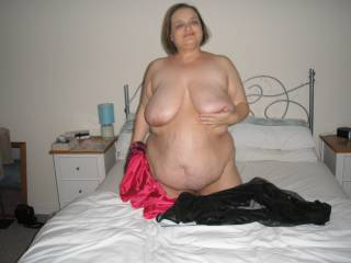 Wife stripping on bed