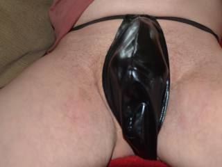 Hiding my naughty cock in my wet look thong.
