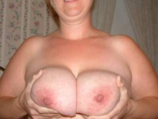 Wife holding her huge 34G tits