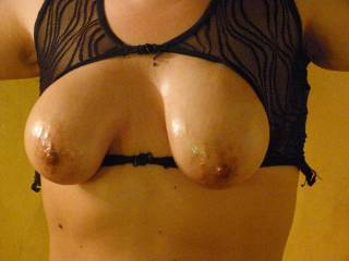 Squeeze my oiled tits please...