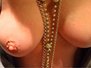 You have beautiful boobs and they hang so perfectly, I would love to see them hanging over my face dipping them down so I can suck on them one then the other, your lovely necklace laying on my chest as you do....