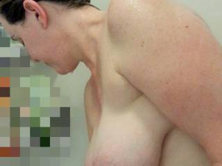 Heavy milk filled tits looking huge in the shower