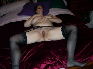 and looking very sexy in those sheer black stockings!!!