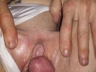 Wife is spreading it open,  look at the size of that clit!  You think she wants a hard dick up in that wet pussy?  Maybe I should put it in her ass next?