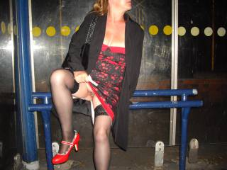Heading home after a wedding, had to wait a few minutes at the bus stop so took the opportunity to show you that NO I don\'t wear panties regardless of the occasion ...lol. Who wants to have a little lick of my pussy as I stand here waiting for the bus?
