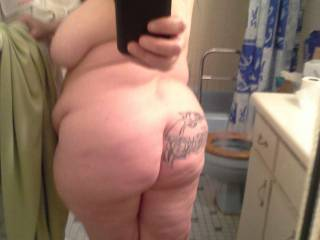 My online slave Cynthina showing her tattooed ass