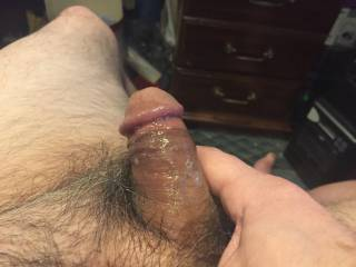 I was sitting in my office looking at some hot porn stroking my cock.  I stroked harder and harder and my cock began to spasm and cum.  I came so hard I actually hit my chin.  This pic is the aftermath - hot cum all over my cock.  Anybody want some?