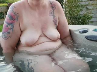 Mrs getting in to the hot tub at the Holiday cabin.