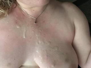 Close-up of Kiki's face and big beautiful bruised up titties covered with cum!  I was fucking her on the couch in my office with people in the office next-door. I surprised Kiki when pulled out and shot my cum right in her face.