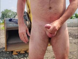 Jerk off and cumming at a construction site. I wonder if anyone in the building behind had seen me
