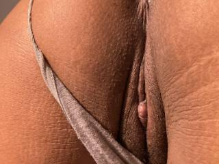 Wife's pussy. Clit is swollen, thong panties pulled to side