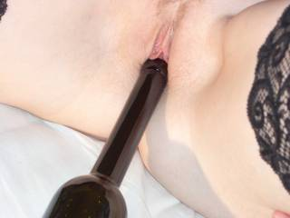 Wife using a bottle to masturbate.
