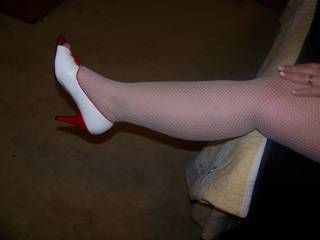should say by request.....perfect legs in stockings and sexy heels.....you may begin worshiping now...