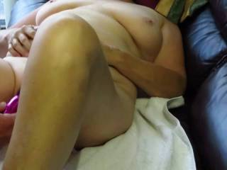 We enjoy light BDSM as foreplay. I used her purple wand to make her pussy very wet, while keeping her nipples pert with the flogger as we watched porn. After she cums we went outdoors for a good fucking where the neighbours might see. Multi-tasking rules!
