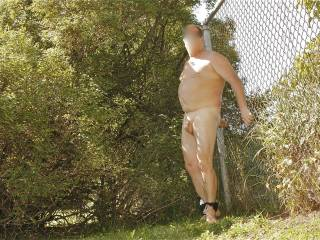 Yes I'd have fun handcuffing you to that fence.  I'd do what ever I wanted to your naked body and dangling cock and balls.  I'd suck on your cock making it very hard....then walk way leaving you cuffed to that fence.  I'd go about 20 feet away squat down and take a void while you watched me.  Id use your underwear to wipe my pussy.  While you are watching me I'd spread my legs and start playing with my pussy and breasts, fingering myself and getting myself off while you can only watch.  After I cum...I'll come over and rub my wet pussy on your legs.  Kneel down and suck your cock and let you cum in my mouth.  K