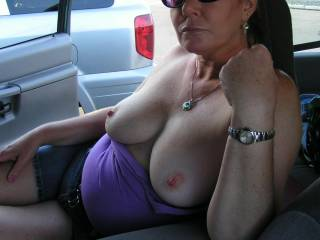 Wish I was their to play with her hot sexy tits. Wold love to jerk off on her tits and play with her pussy as she sucks my cock.This is my favorite photo so far of her.
