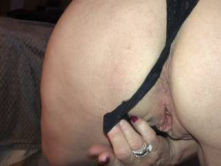 pulling my panties aside to sit on his cock