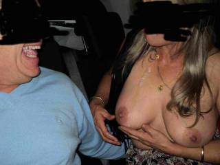 Guy has just cum in her mouth and she just dribbled it down her chin and onto her tit to show she sucked him off!
