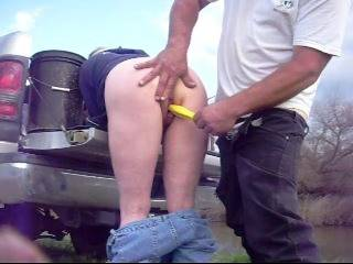 bent over the tailgate and fucking her with a snap on screwdriver handle while fishing