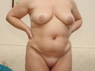 Lovely.  May I stand behind you and fondle those delightful breasts.  You'll feel my cock getting hard against your buttocks...