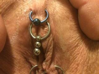 Just a super close shot of her new jewelry. We played Hell trying to find The dangling ball that hangs over the clit. I absolutely love her pussy. What do you think?