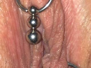 I've never had the opportunity to try this, but I'd like to see a thread or elastic tied around the top of each thigh, threaded through her lip rings; as she opens her legs it should part her lips, presenting open pussy, mmmm!