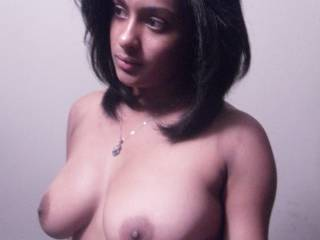 Wow! She is absolutely stunning and has the most amazing tits...perfect size, shape, big aerolas (my favorite!) and deliciously hard nipples!!