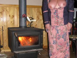 Northernbelle being a Northernbelle.  Fire blazing to keep warm but nice tits hanging out for all to see.