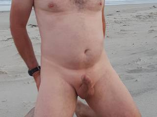 Got nice and hard having my smooth cock photography at the beach.
