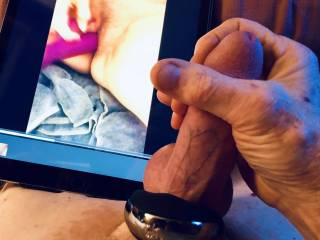 Vibrating cock ring is causing my sperm to rise as I watch her masturbating.