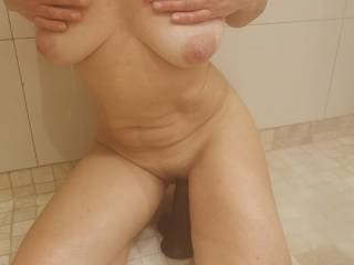 Did a set of pics while enjoying a warm shower with my big black dildo. Enjoy and tell us about your thoughts. Don\'t miss the video!