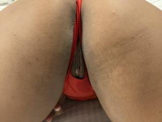 Wife's ass and pussy in crotchless thong from behind.