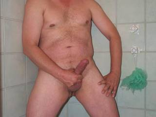 Jacking off in the shower.  The result is an erect cock!