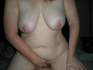 My sexy wife sitting on my cock playing with her clit.
