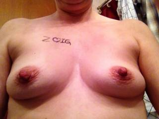 mmmm sweetheat what lovely tits and nipples! would be a sheer delight to lick and suck those! how about one for hubby and one for me?